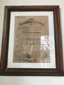 Framed charter with water damage