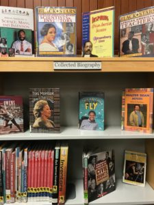 Three shelves of biographies, including books about African-American scientists, teachers, and inventors and people of the Civil Rights Movement.